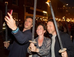 Olivia Colman and James D'Arcy star in Bridport torchlight procession